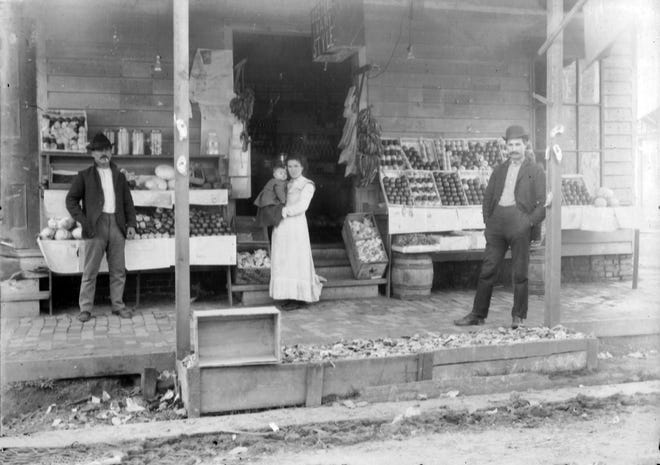 Photo from a glass negative that some believe is the original Ventre Store on the northwest corner of Court and Grolee streets, c. 1890s. This store building was demolished in 1906 and a new Ventre store built on the corner directly across Court street.
