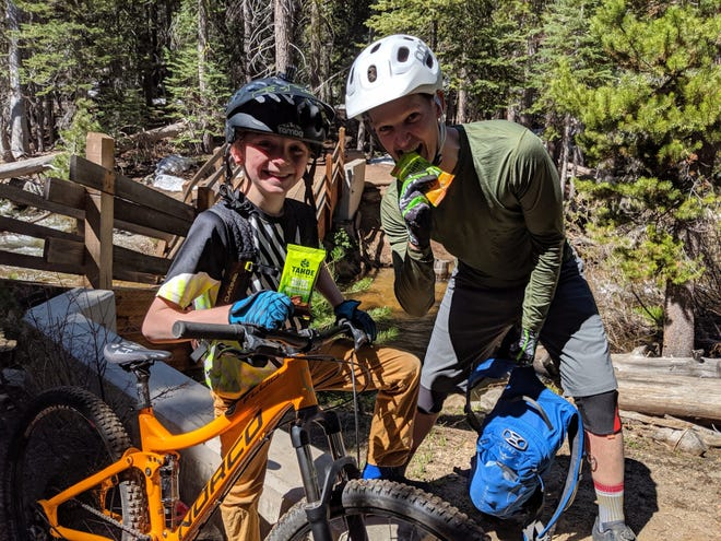 Tahoe Trail Bar founder and CEO Wes King takes to the trail with Max Fish, a youth ambassador for the energy bar company, based in South Reno.