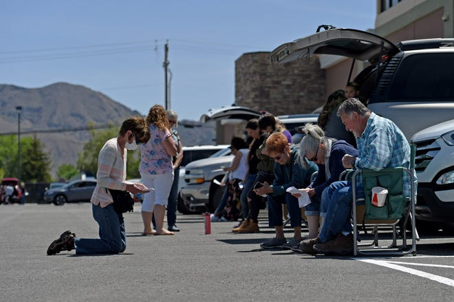 Calvary Chapel church members participated in the National Day of Prayer in the church parking lot. Their plan was to have cars parted on every-other parking spot, but the turnout was larger than they expected.