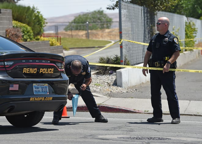 Reno police pick up evidence were a shooting occurred next to the Creekside Townhome Apartments on Thursday July 16, 2020.