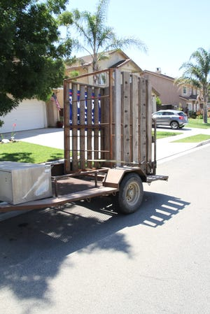 The Monterey County Sheriff's Office is investigating why an employee left this trailer with a livestock cage and a Trump 2020 flag on it in front of a house in Soledad. July 16, 2020.
