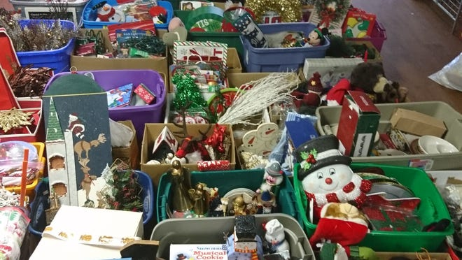 The Bargain Basement Thrift Store in Baltic is lined with hundreds of boxes of Christmas items that will be auctioned off on Saturday, July 25.