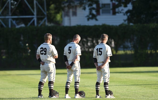 Rockies outfielders stand together for the national anthem before their game against Luxemburg Wednesday, July 15, 2020, in Cold Spring.