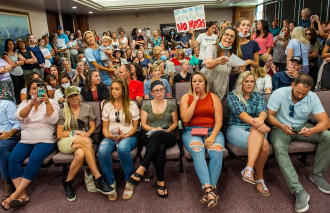 A Utah County Commission meeting was adjourned before it even started July 15 in Provo, Utah, after a group protesting mask mandates in schools removed the social distancing tape on the chairs and filled the Utah County Commission room to overflowing.