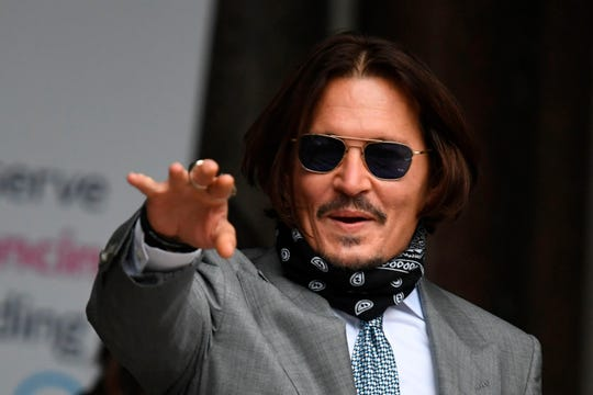 Johnny Depp arrives on day eight of his libel trial against The Sun tabloid in London on July 16, 2020.