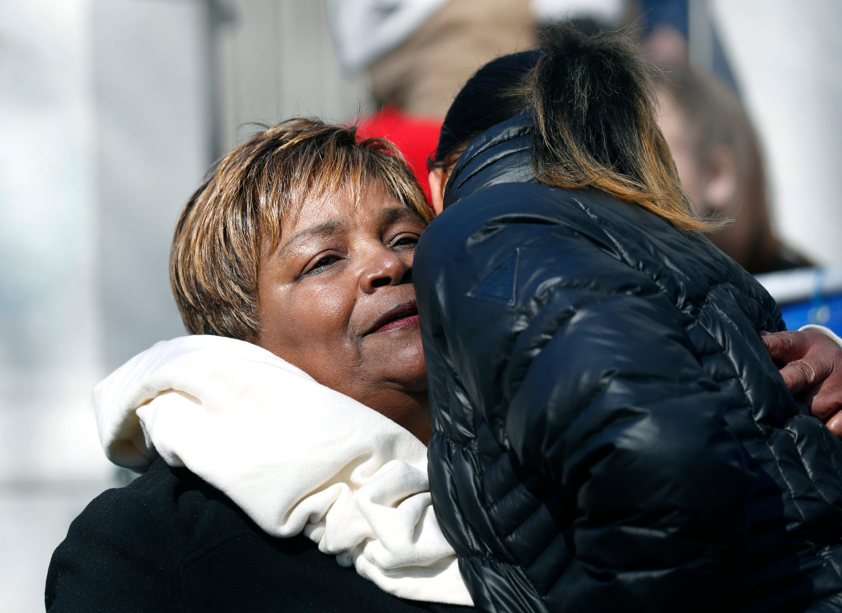 Lentory Johnson, whose son Johnny Ray Johnson was one of the victims in the triple homicide at the Boys & Girls Club of Rochester in 2015, gets a hug after her speech before the start of the Rochester March for Our Lives Rally starting at Washington Square Park in Rochester, New York. (Via OlyDrop)