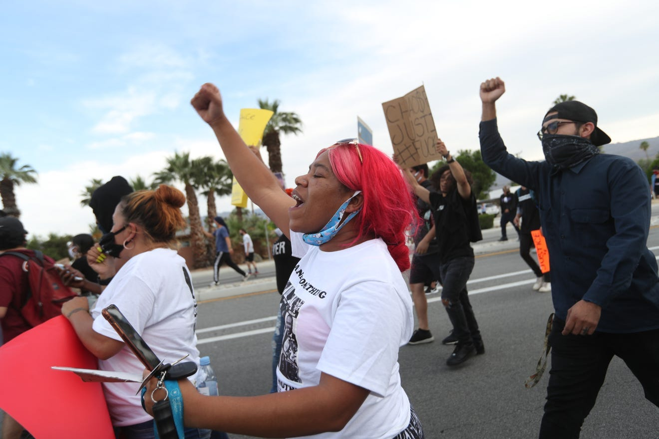 Nicole Smith of La Quinta marches in Palm Desert, California, on June 1 as part of the nationwide civil unrest following the death of George Floyd. Taya Gray/The Desert Sun