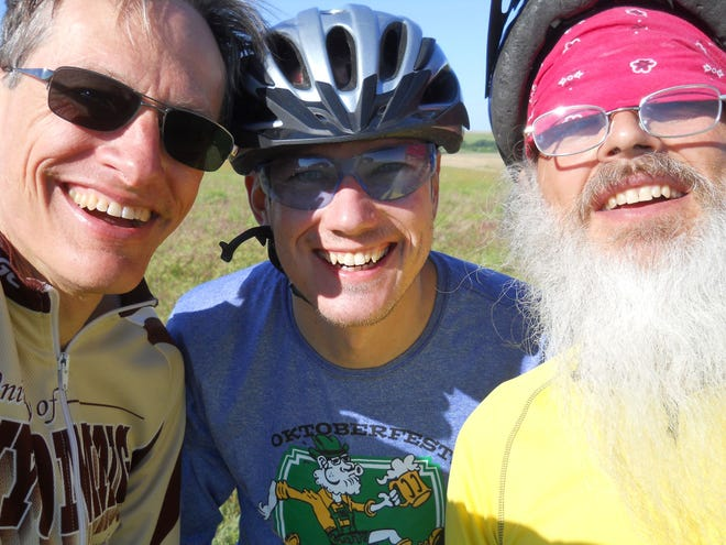 Pratt community member Brandon Case, left, enjoys cycling and hanging out with friends regularly, when not at work, mask free until April of this year. He asks others to join him in masking up to help stop the local spread of the coronavirus.