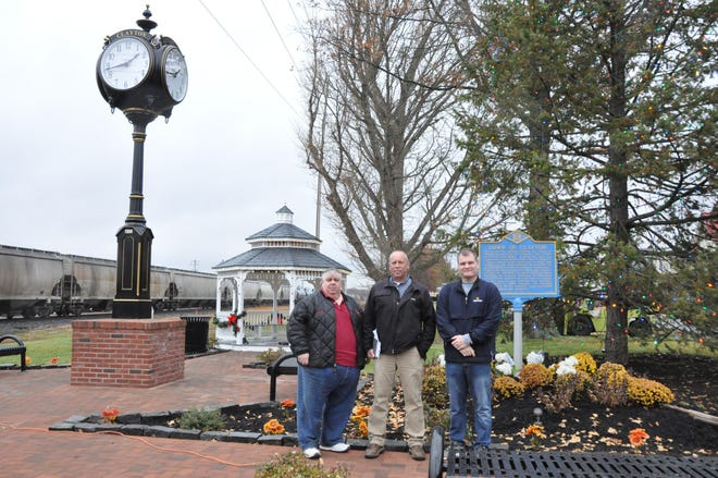 From left, Clayton Councilman Skip Carrow and town Economic Development Committee members  Ed Ide and Eric Young at the town's new park at the corner of Main and Bassett streets.