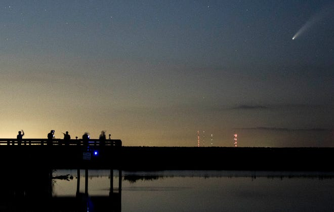 Photographers and stargazers search the skies for comet NEOWISE along the St. Johns River west of Cocoa, FL Thursday, July 16, 2020.