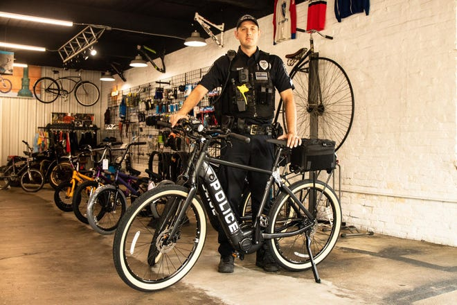 Sergeant Micah Shanks of the Chillicothe Police Department with a new Ebike outside of Rivers' Bend bike shop in July 2020.