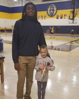Moeller's Evan Mahaffey with a young fan