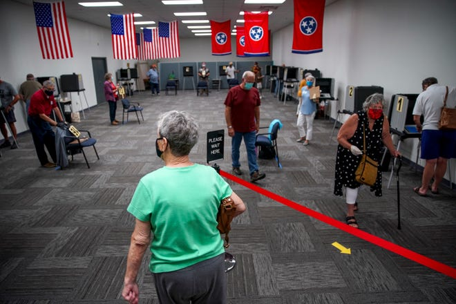 Residents part up into their booths to cast their ballots during the first day of early voting for the August 6th election at Montgomery County Election Commission in Clarksville, Tenn., on Friday, July 17, 2020.