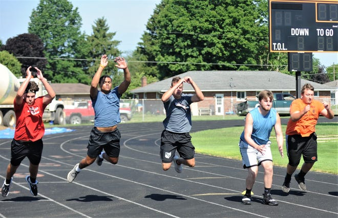 Ridgewood players perform a jumping drill during summer conditioning. Football teams have been working the past two months in preparation for the upcoming season.