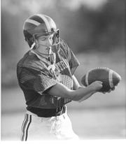 Before Jim Abbott was a star at Michigan and the MLB, he was a football player at Flint Central.