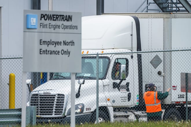 A truck waits to load at General Motors Flint Assembly on May 18, 2020, during the first day back to work since the plant closed due to COVID-19.