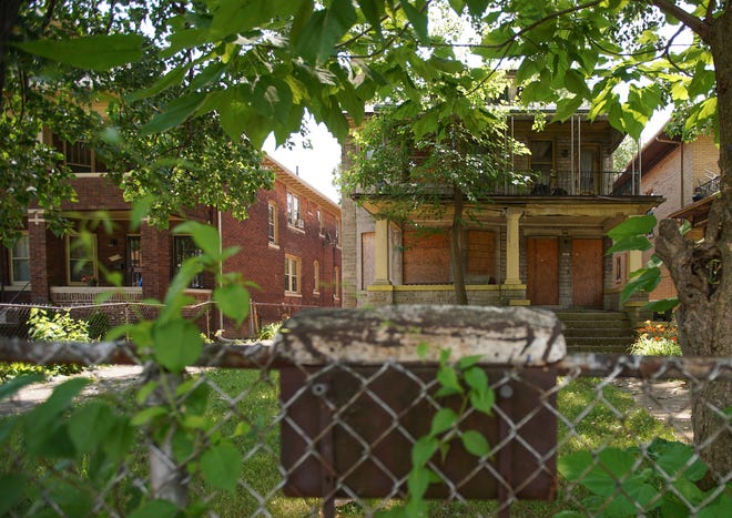 Boarded windows are seen on the blighted house in Detroit's Virginia Park neighborhood on July 6, 2020.