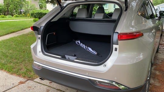 The The 2021 Toyota Venza's cargo compartment is relatively small and has a high liftover.