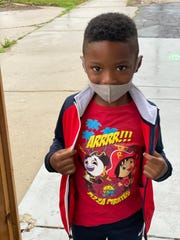 A student at the newly reopened Blessed Beginnings Learning Center. Masks aren't recommended by the state for children at play outdoors.