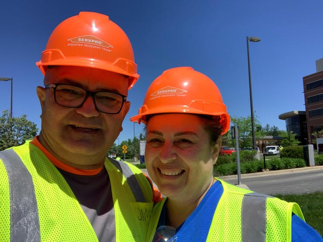 Armando Negron, 56, (left) and Marali Rubio, 50, were in the Midland area in Michigan in late May and early June, after a flood to help clean up buildings, including a hospital, MidMichigan Medical Center - Midland. They were part of about 200 workers, most of them immigrants, who came to Michigan to help with cleanup, working for a subcontractor. They and other workers said their safety was ignored and as a result, got infected with the coronavirus. They are now back at home in Florida.