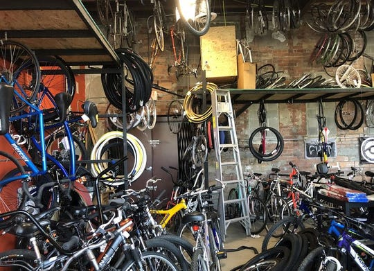 Hughes' shop is crammed full of bikes in need of repair -- he's subsisting on fix-it work since he can't order new bikes.