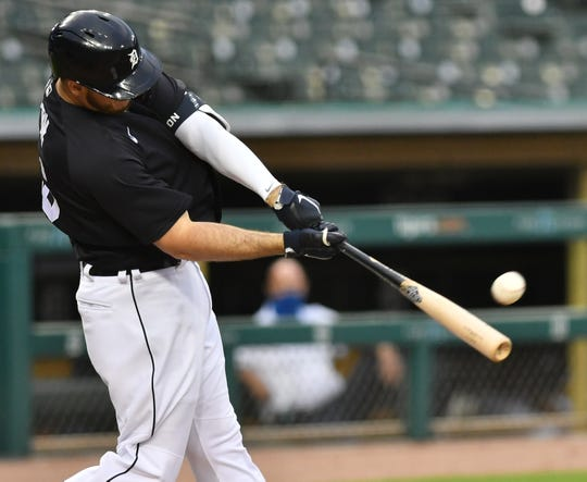 Tigers' C.J. Cron hits a solo home run during an intrasquad game at Detroit Tigers Summer Camp at Comerica Park in Detroit on July 16, 2020.