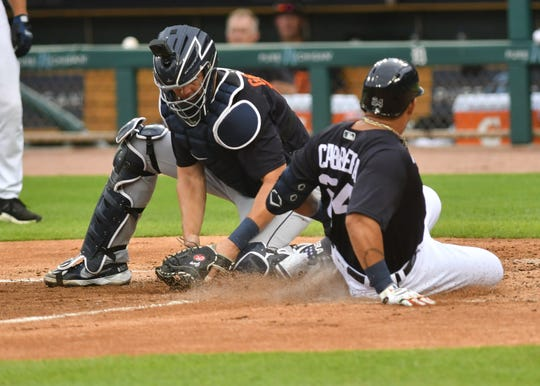 Tigers' Miguel Cabrera beats the tag by catcher Grayson Greiner at home plate during an intrasquad game at Detroit Tigers Summer Camp at Comerica Park in Detroit on July 16, 2020.