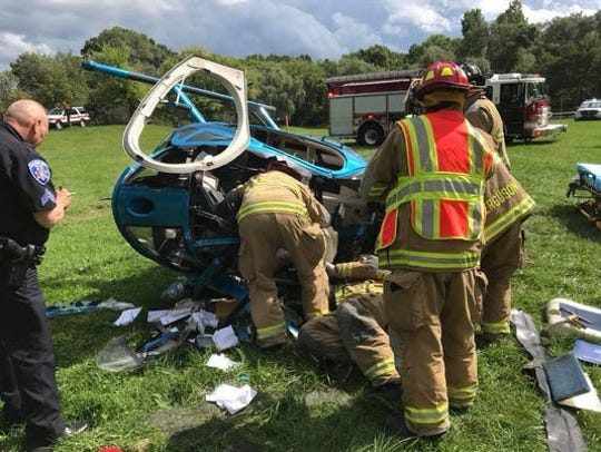 Police and firefighters respond to a helicopter crash Sept. 3, 2018, in Orchard Lake.