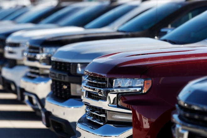 GM said Thursday it will begin building pickups in Ontario to meet strong demand.