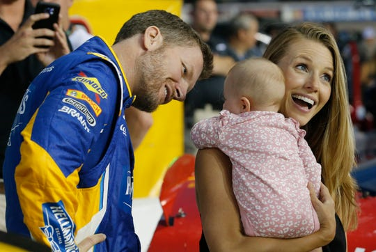 In this Sept. 21, 2018, file photo, Dale Earnhardt Jr. looks at his daughter, Isla, and his wife Amy on pit row prior to an Xfinity Series NASCAR auto race in Richmond, Va.