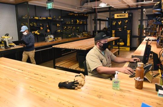 Miguel Mereles works in the tool-lending department at Carhartt's Midtown store. DeWalt tools are big part of the offerings.