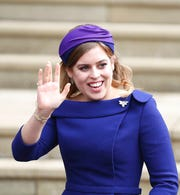 In this Friday Oct. 12, 2018 file photo, Britain's Princess Beatrice arrives for the wedding of Princess Eugenie of York and Jack Brooksbank at St George's Chapel, Windsor Castle.