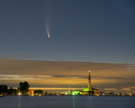 Local photographer Ethan Allen captured this image of Comet NEOWISE at 4:30 a.m. Monday from Lake St. Clair in front of the Grosse Pointe Yacht Club.