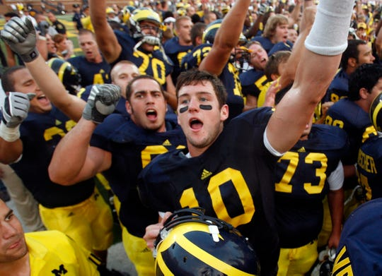 Michigan quarterback Steven Threet celebrates after defeating Wisconsin 27-25 at Michigan Stadium on Sept. 27, 2008. (David Guralnick/Detroit News)