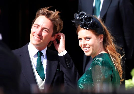 In this Aug. 31, 2019 file photo, Britain's Princess Beatrice with her fiance, Edoardo Mapelli Mozzi, attend the wedding of Ellie Goulding and Caspar Jopling, in York, England.