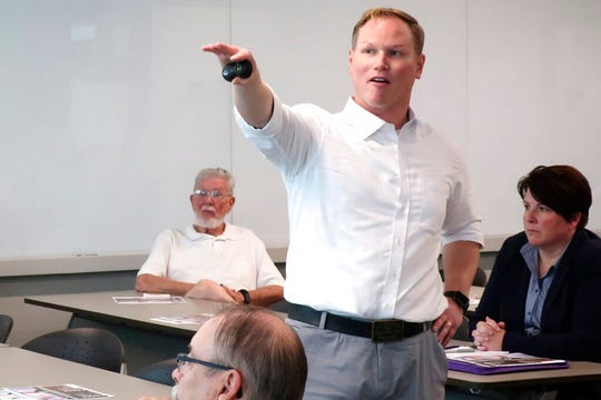 In this Aug. 26, 2019 file photo, U.S. Rep. Steve Watkins, R-Kan., makes a point during a town hall meeting in Topeka, Kan.