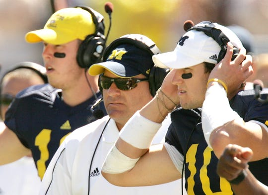 Michigan backup QB David Cone, from left, head coach Rich Rodriguez and QB Steven Threet stand on the sideline during a 16-6 victor over Miami of Ohio at Michigan Stadium on Sept. 6, 2008. (John Greilick/Detroit News)