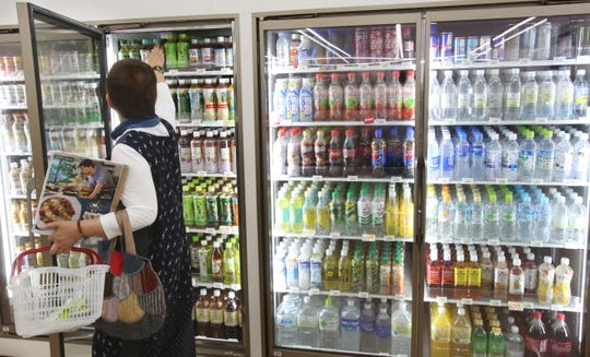 Plastic-bottled soft drinks are displayed in fridges at a store in Yokohama, near Tokyo.
