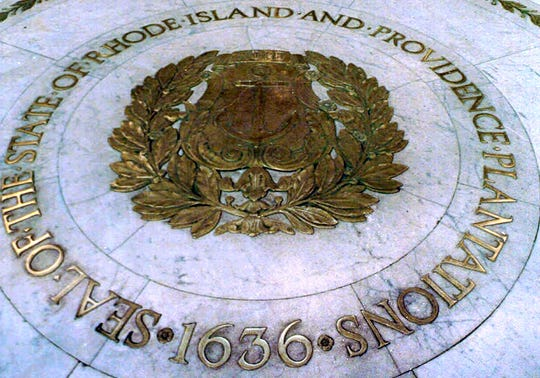 The seal of the State of Rhode Island and Providence Plantations on the floor of the Statehouse rotunda in Providence, R.I.