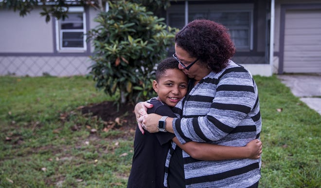 Etzia Hamilton and her son, Jayvion, 9, stand for a portrait at their Lehigh Acres home on Thursday, July 16, 2020. Both tested positive for COVID-19 last month. Both had mild symptoms and have recovered and tested negative since. There has been an uptick in children testing positive for COVID-19.