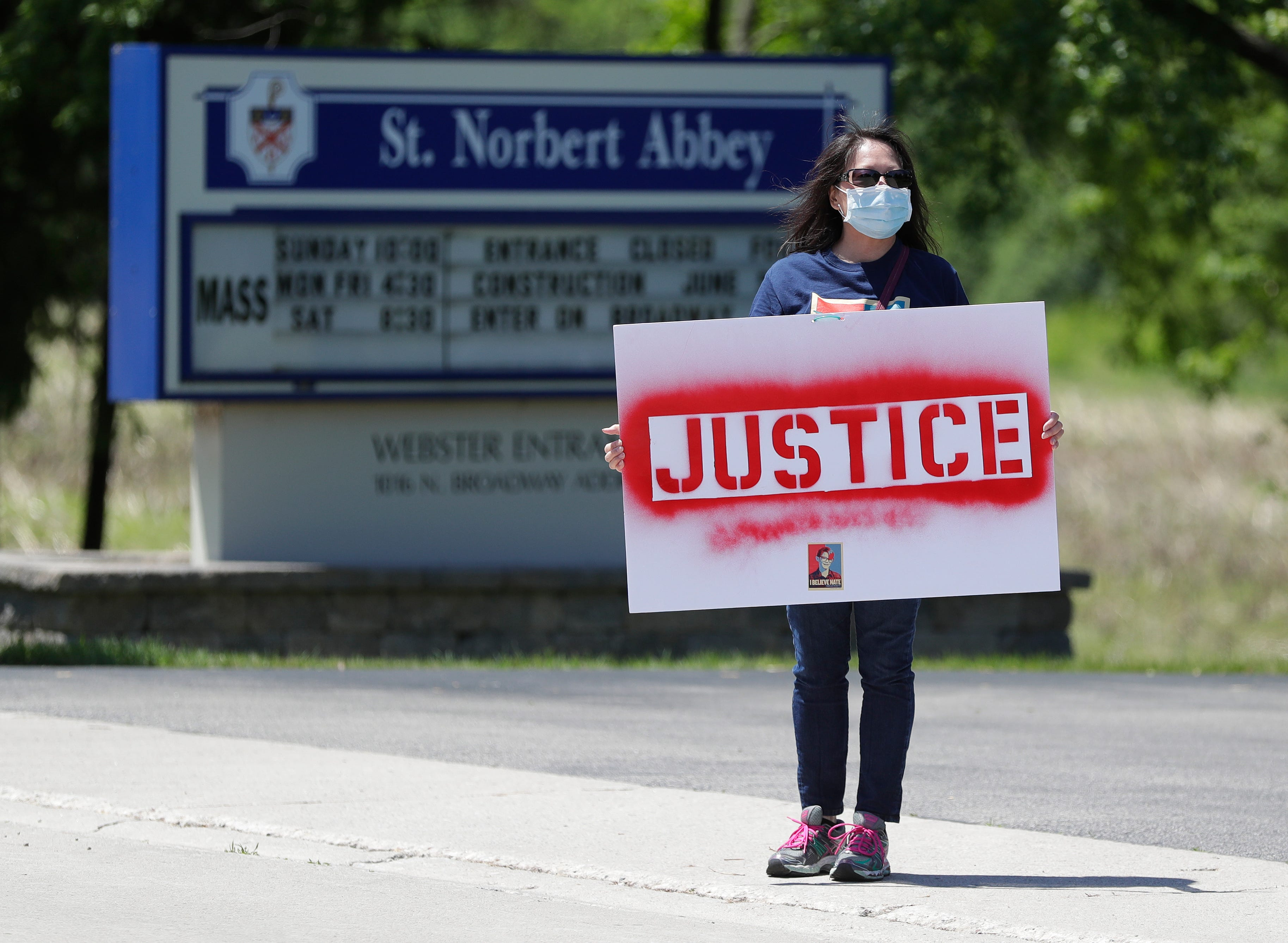 Emily Harrison, friend of Nate Lindstrom and Chicago resident, protests outside St. Norbert Abbey on June 6, 2020, at the De Pere-Allouez border. Lindstrom, 45, said three priests sexually abused him as a teen; he died by suicide in March 2020.