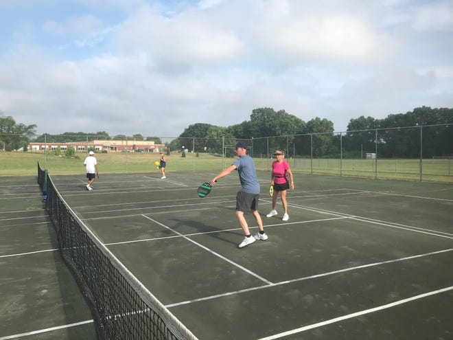 Pickleball player Don Thompson shown here following through after striking the ball comes from Logan to play at Jerry Maher Park.