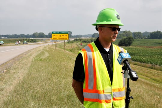 Jason Sturgeon, the deputy director of Ohio Department of Transportation District 5, stands in front of signs alerting drivers to the new distracted driving safety corridor. It's a 12-mile stretch of road on US 33, created through a partnership between OSHP and the Ohio Department of Transportation.