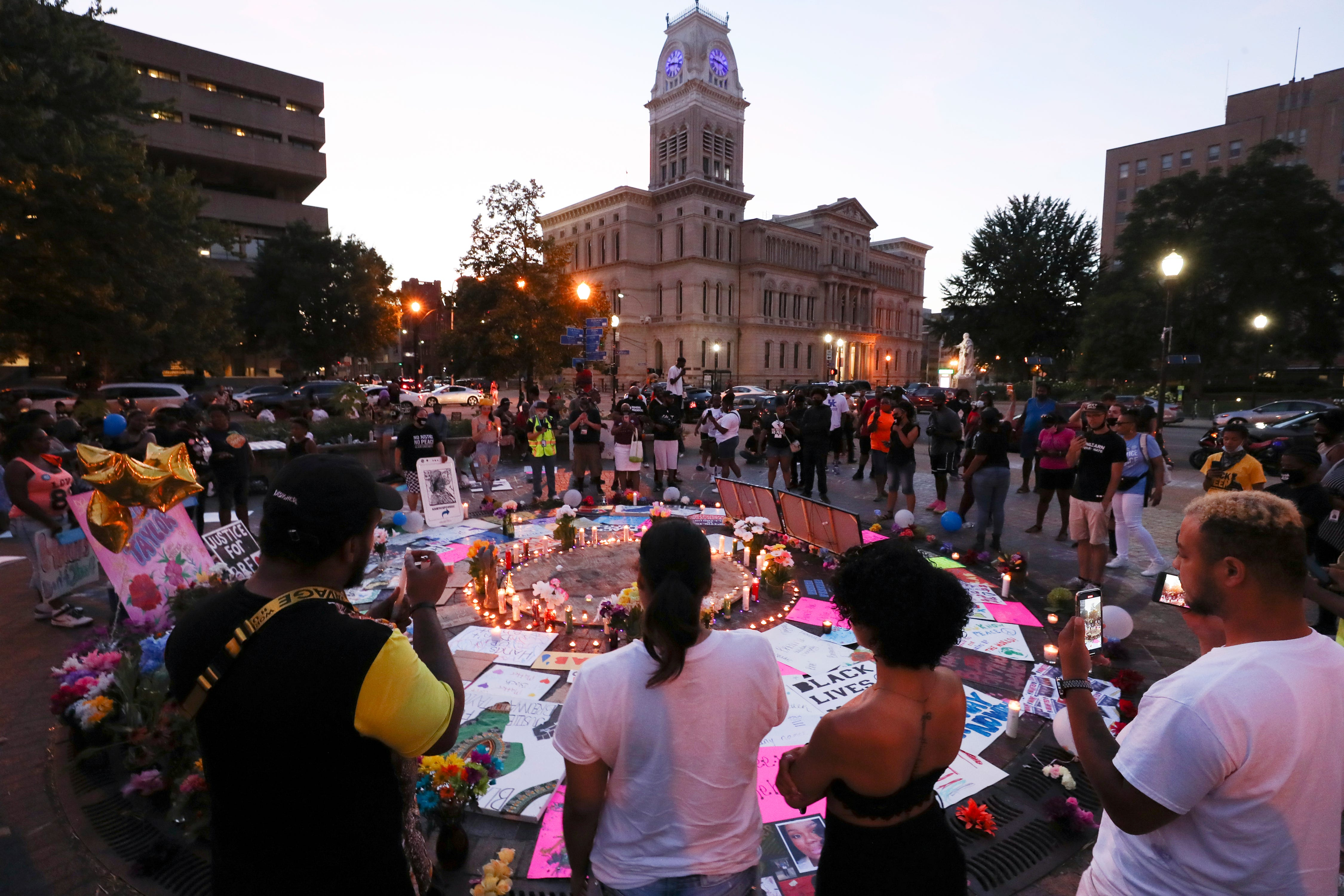 Protesters gathered around lighted candles at Breonna's Circle in Jefferson Square Park on July 16, 2020 to mark the 50th day of protests following the death of Breonna Taylor at the hands of LMPD.