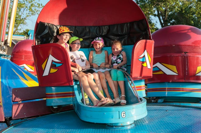 The Tilt-A-Whirl ride spins friends (from left) Samiya Newton, Sebastian Newton, Hannah McLellan and Sophia McLellan at Lionfest in 2016. This year's event has been canceled due to coronavirus.
