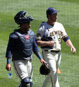 Brandon Woodruff, with catcher Omar Narváez, picked up in exhibition play where he left off when spring training was cut short.