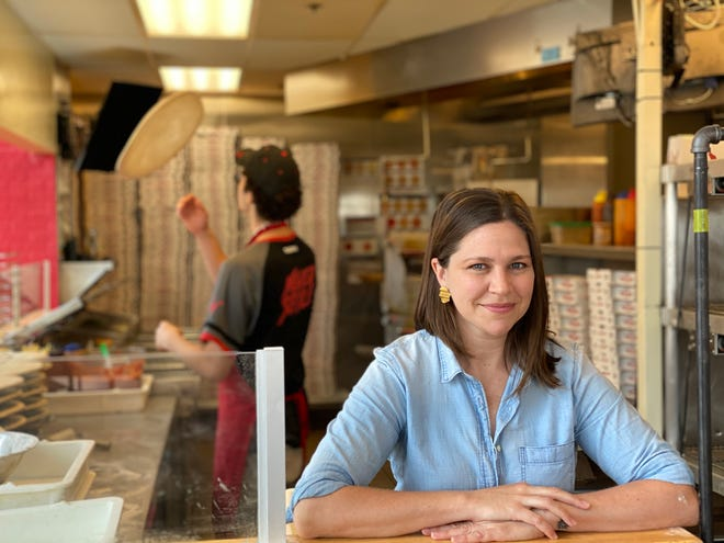 Plant-based chef Melanie Manuel poses in a Toppers Pizza kitchen.