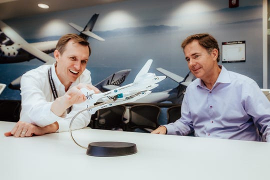 In a publicity photo, Virgin Galactic's former CEO George Whitesides, left, appeared with incoming CEO Michael Colglazier. Both are named in a federal lawsuit over the company's accounting and financial reporting.