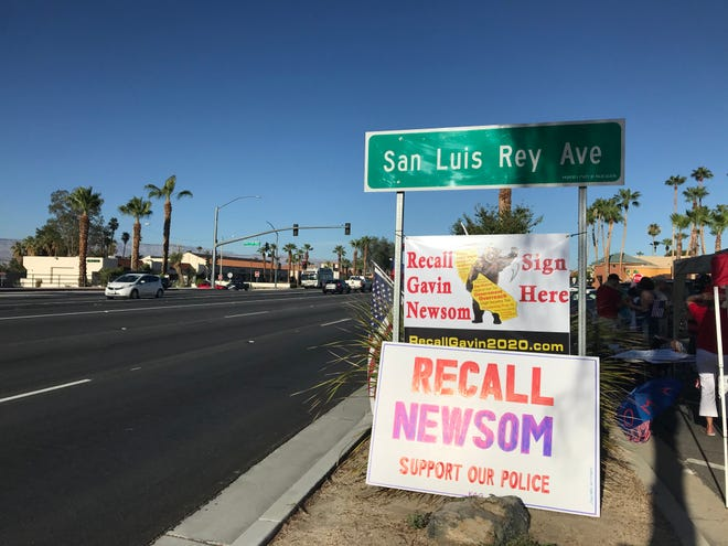 The rally was held near the corner of Highway 111 and San Luis Rey Avenue.