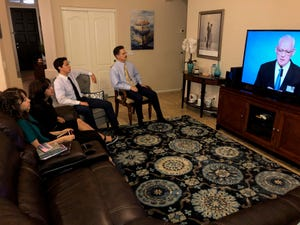 The Locke family watches Jehovah's Witness programming on July 12, 2020.